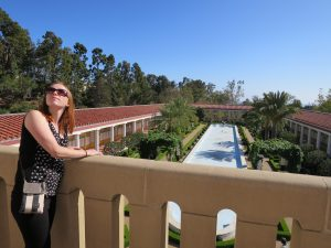 Emily glances at the third floor of the Getty Villa.
