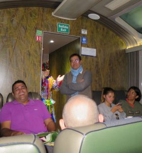 The passengers went wild over the male train attendant's modeling.